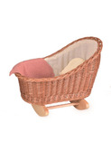Wicker cradle with knitted blanket